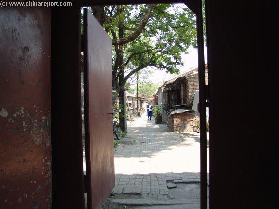 An ancient Hutong Alley with small Greenhouses ...
